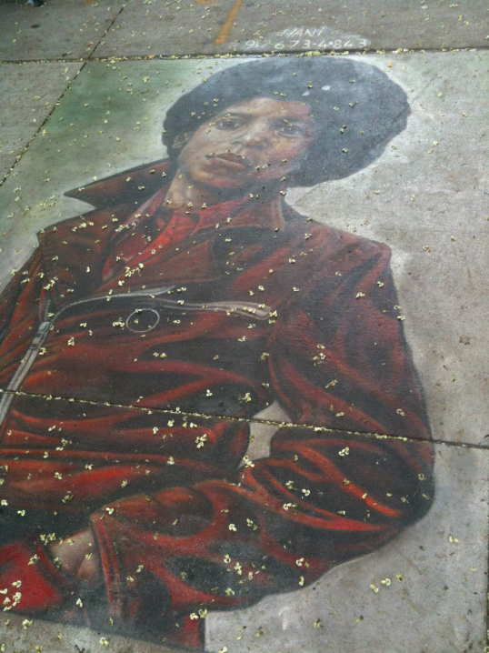 Hani Shihada sidewalk mural of Michael Jackson after the rain