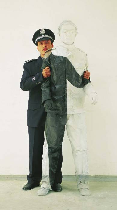 Liu Bolin Hiding in the City No. 16 Peoples Policeman 2006