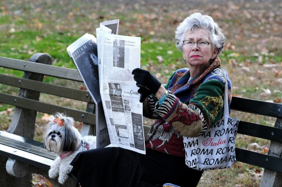 Woman reading the paper in Central Park, NYC, photograph by Jeff Colen