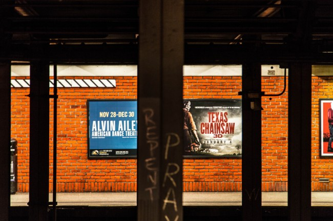 Three-way clash of cultures. New York Subway. Photograph by Ric Camacho